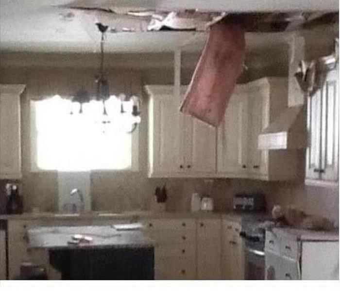kitchen with insulation hanging down from a water damaged ceiling