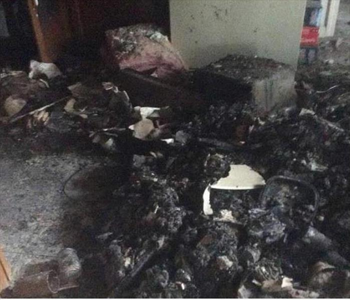 piles of blackened and burnt contents on a floor