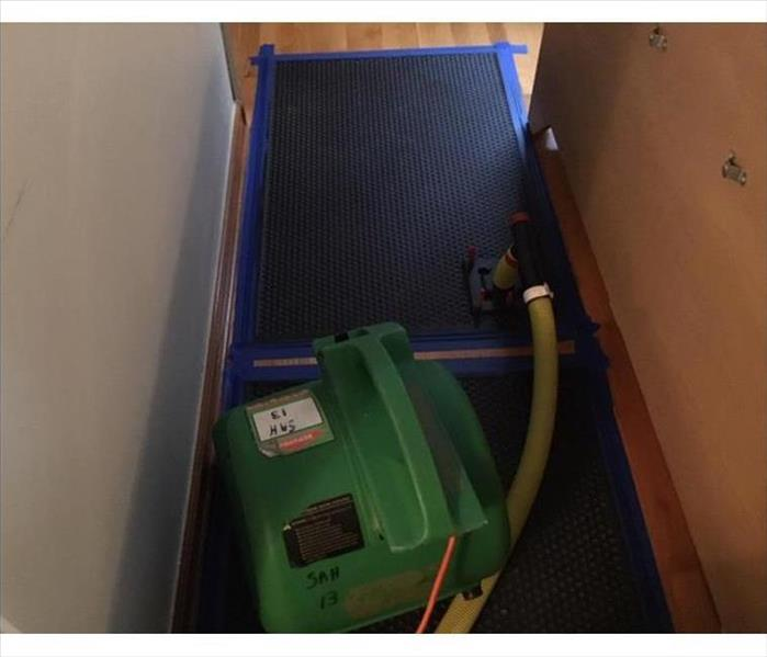 drying mats and airmover in hallway